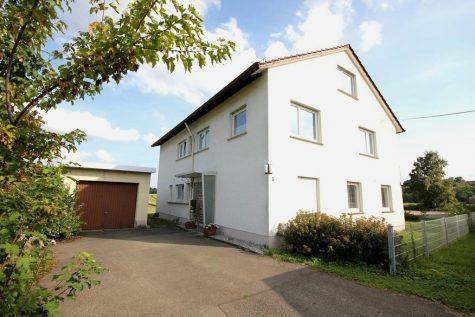 Wohnhaus mit Garage, Mieteinnahmen und einem sehr guten Raumangebot in schöner Feldrandlage, 72124 Pliezhausen, Einfamilienhaus